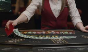 Casino dealer laying out playing cards
